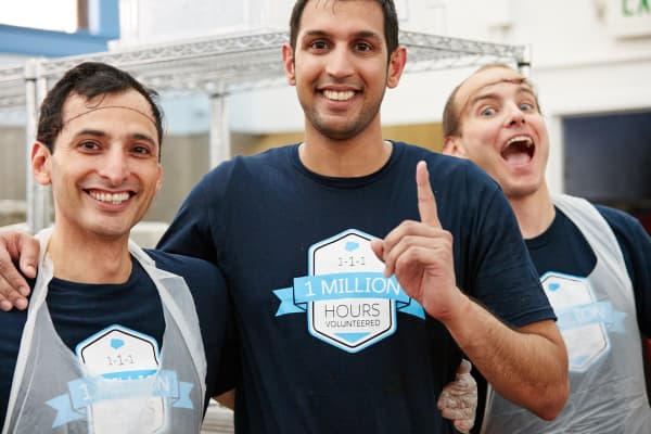 Salesforce offers its employees paid volunteer time off. These employees spent time volunteering at a soup kitchen.